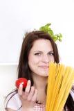 藏品意大利面食微笑的蕃茄妇女 库存图片