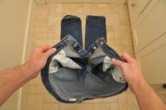 藏品放置他们的人裤子 库存图片