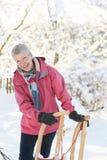藏品横向高级爬犁多雪的妇女 免版税图库摄影