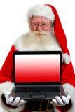 藏品膝上型计算机圣诞老人 免版税库存图片