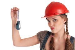 藏品评定嬉戏的磁带女工年轻人 免版税图库摄影