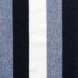 藏青色和白色镶边棉花聚酯纹理 库存图片