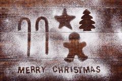 藤茎、ginberbread人、星、树和文本圣诞快乐 免版税库存图片