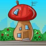 以蘑菇的形式动画片房子 库存图片