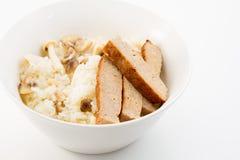 蘑菇黏米饭和火腿 库存照片