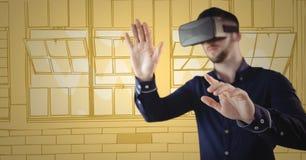 虚拟现实耳机的人实施反对黄色手拉的窗口 免版税库存图片