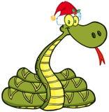 蛇与圣诞老人帽子的漫画人物 免版税库存图片