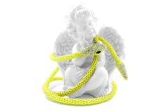 蛇项链和天使 免版税图库摄影