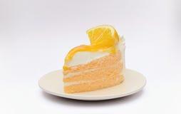 蛋糕切片和给上釉的橙色果酱 免版税库存图片