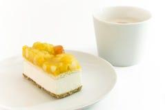 蛋糕咖啡凝乳水果的设置 库存图片