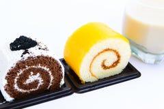 蛋糕巧克力和牛奶在白色背景 库存图片