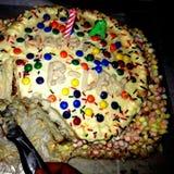 蛋糕桃子五颜六色的咬 免版税图库摄影