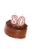 蛋糕:结块庆祝第80个生日 免版税库存图片
