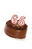 蛋糕:结块庆祝第65个生日 免版税库存照片