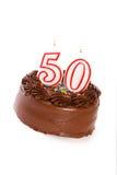 蛋糕:结块庆祝第50个生日 图库摄影