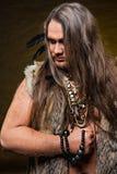 蛮子的图象的人有小珠和羽毛的装饰的 库存图片