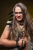 蛮子的图象的人有小珠和羽毛的装饰的 库存照片