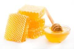 蜂窝和一碗蜂蜜 库存图片