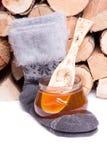 蜂蜜和温暖的棉花袜子 免版税库存照片