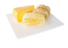 蜂蜜梳子用乳酪 免版税图库摄影