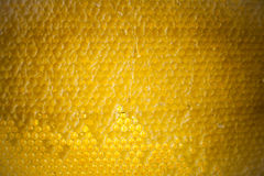 蜂蜜梳子背景或纹理 库存图片