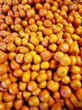 蜜桔在市场上 免版税库存图片