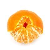 蜜桔果子,当部分地被剥皮的皮肤被隔绝在白色背景 图库摄影