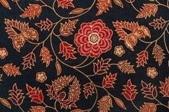 蜡染布黑色模式红色纺织品 库存图片