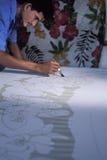 绘蜡染布,特立尼达的人 免版税图库摄影