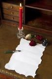 蜡烛信函玫瑰 库存图片