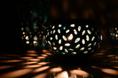 蜡烛光和绿色阴影 库存图片