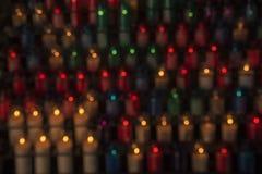蜡烛光的被弄脏的背景 免版税库存图片