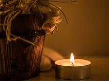蜡烛和Backet 库存图片
