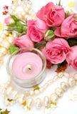 蜡烛桃红色玫瑰 库存图片