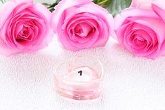 蜡烛玫瑰 免版税库存图片