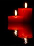 蜡烛纵向回报了水 免版税库存图片