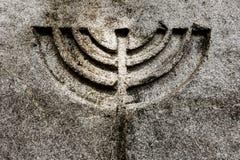 蜡烛menorah标志石头自然本底 库存图片