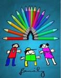 蜡笔和孩子画。 库存照片