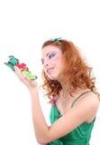 蝴蝶头发的红色妇女 免版税库存图片