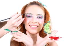 蝴蝶头发的红色妇女 免版税图库摄影