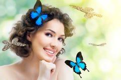 蝴蝶妇女 库存照片