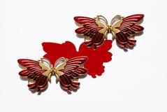 蝴蝶金属红色二白色 库存照片