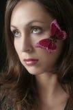 蝴蝶面颊她的妇女 免版税库存照片