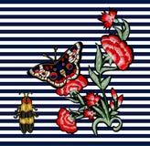 蝴蝶、甲虫和花刺绣 免版税库存图片