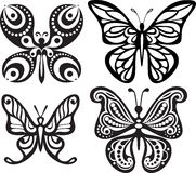 蝴蝶剪影与开放翼网眼图案的 黑白图画 用餐装饰 库存照片