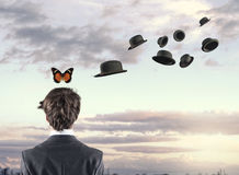 蝴蝶和帽子 库存照片