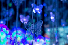 蝴蝶形状的装饰光 免版税库存照片