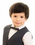 蝶形领结的聪明的男孩 库存照片