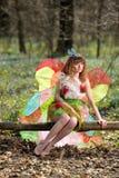 蝴蝶的图象的美丽的女孩 免版税库存图片
