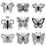 蝴蝶,在白色背景的黑剪影 免版税库存图片